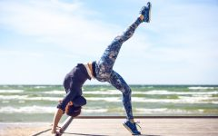 48085921 - woman practicing yoga on the coast of sea, sunny day